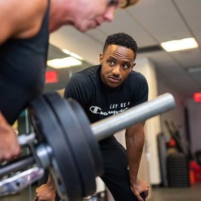 personal trainer helping a YMCA Pittsburgh member